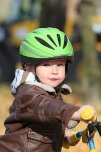 bigstock-Baby-boy-in-helmet-learning-to-18984527