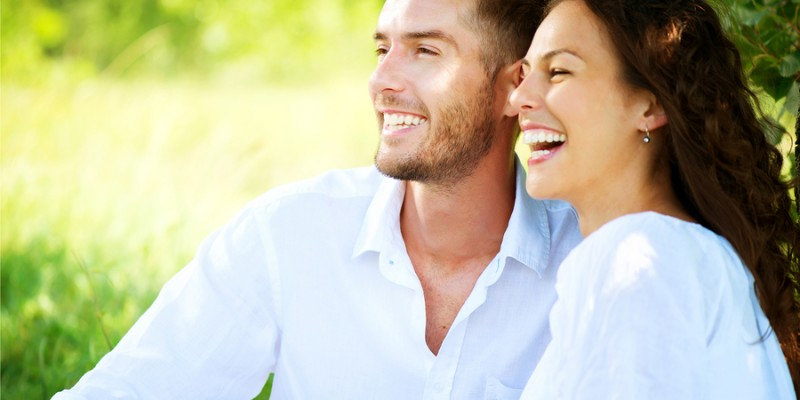 Happy Couple Outdoor. Smiling Couple Relaxing in a Park. Family